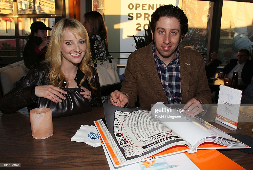 Actors Melissa Rauch (L) and Simon Helberg attend a reception to celebrate the release of Chuck Lorre's 'What Doesn't Kill Us Makes Us Bitter' at Mixology101 & Planet Dailies on October 24, 2012 in Los Angeles, California.