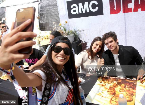 Actors Mercedes Masohn and Daniel Sharman pose for a fan selfie at the 'Fear the Walking Dead' Autograph Signing for AMC At Comic Con 2017 Day 3 on...