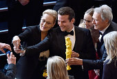 Actors Meryl Streep and Bradley Cooper and actor/director Clint Eastwood take a selfie onstage during the 87th Annual Academy Awards at Dolby Theatre...