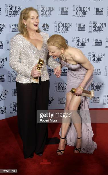 Actors Meryl Streep and Nicole Kidman share a laugh backstage during the 60th Annual Golden Globe Awards at the Beverly Hilton Hotel on January 19...