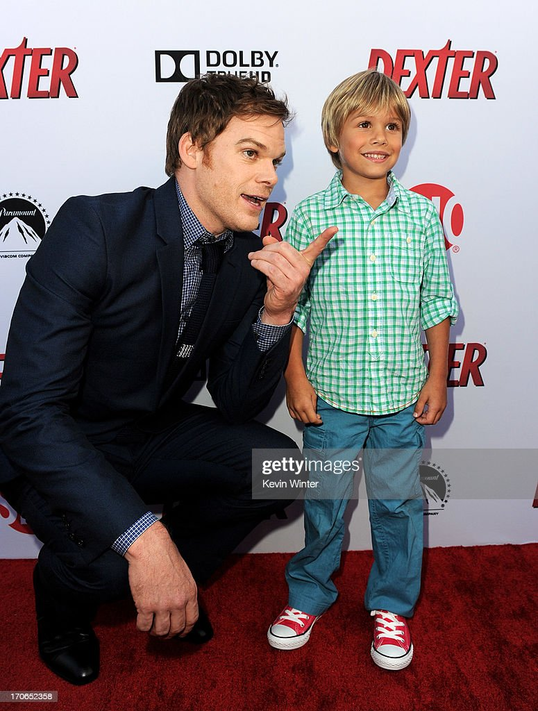 Actors Michael C. Hall (L) and Jadon Wells arrive at the premiere screening of Showtime's 'Dexter' Season 8 at Milk Studios on June 15, 2013 in Los Angeles, California.