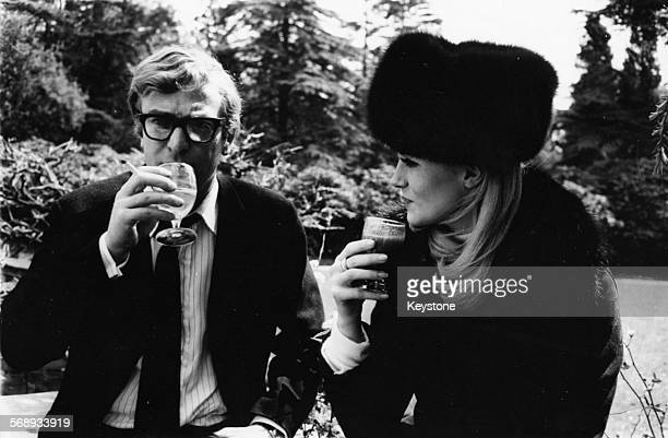 Actors Michael Caine and Francoise Dorleac drinking together during a break in the filming of 'Billion Dollar Brain' at Pinewood Studios London circa...