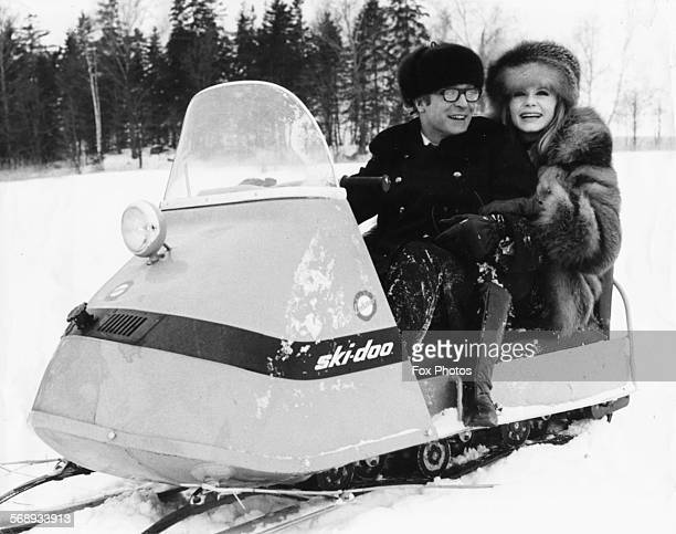 Actors Michael Caine and Francoise Dorleac riding a snow mobile during the filming of 'Billion Dollar Brain' in Helsinki circa 1966