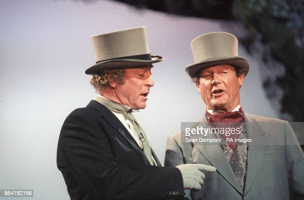 Actors Michael Caine and Roger Moore rehearse at the London Palladium for the Queen Mother's royal birthday gala
