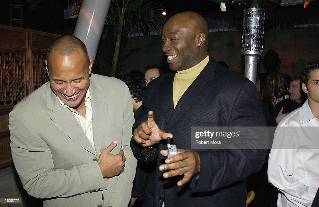 Actors Michael Clarke Duncan (R) and Duane 'The Rock' Johnson attend the unveiling of GQ Magazine's Hollywood Issue at the GQ Lounge at White Lotus on February 20, 2003 in Hollywood, California. The party was the official kick-off to the GQ Lounge, a GQ designed nightclub that brings the pages of the magazine to life for one week.