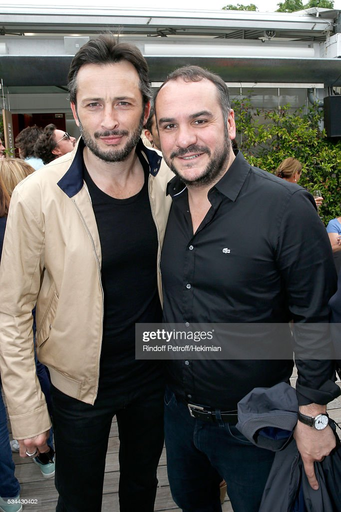 Actors Michael Cohen and Francois Xavier Demaison attend the 2016 French Tennis Open - Day Four at Roland Garros on May 25, 2016 in Paris, France.