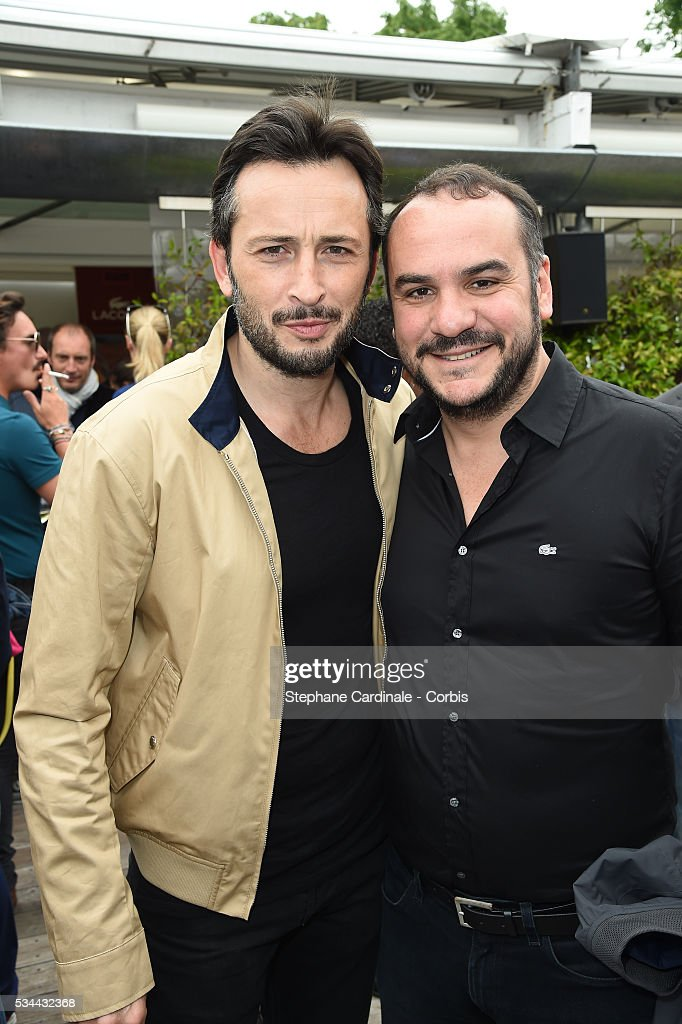 Actors Michael Cohen and Francois-Xavier Demaison attend day five of the 2016 French Open at Roland Garros on May 26, 2016 in Paris, France.