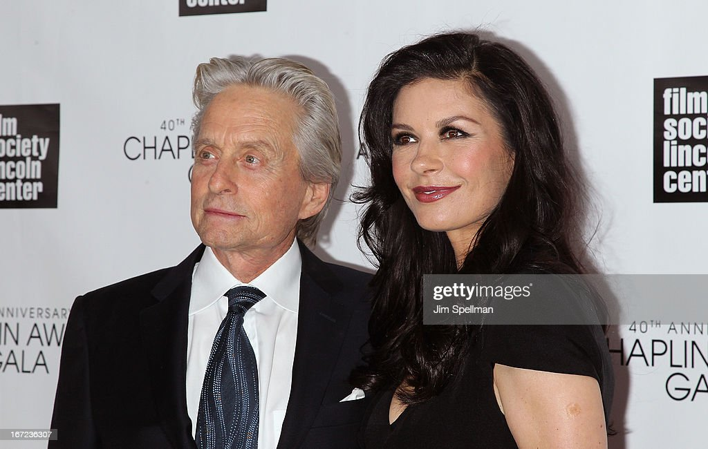 Actors Michael Douglas (L) and Catherine Zeta Jones attend the 40th Anniversary Chaplin Award Gala at Avery Fisher Hall at Lincoln Center for the Performing Arts on April 22, 2013 in New York City.