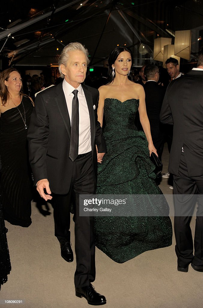 Actors <a gi-track='captionPersonalityLinkClicked' href=/galleries/search?phrase=Michael+Douglas&family=editorial&specificpeople=171111 ng-click='$event.stopPropagation()'>Michael Douglas</a> and Catherine Zeta Jones attend The Weinstein Company and Relativity Media's 2011 Golden Globe After Awards Party presented by Marie Claire held at The Beverly Hilton hotel on January 16, 2011 in Beverly Hills, California.