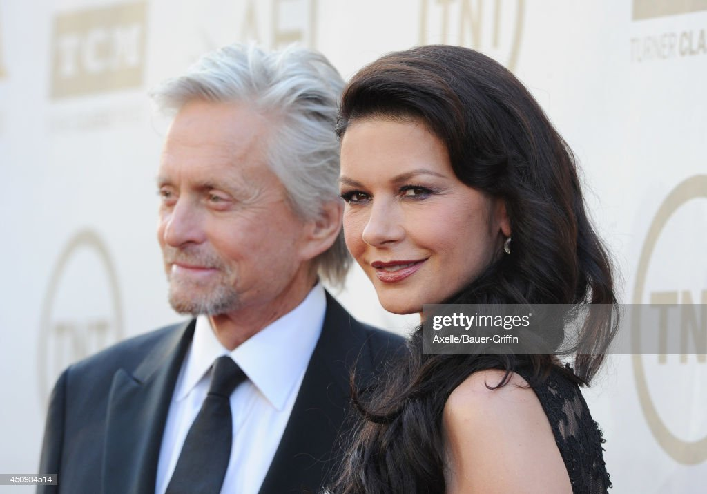 Actors <a gi-track='captionPersonalityLinkClicked' href=/galleries/search?phrase=Michael+Douglas&family=editorial&specificpeople=171111 ng-click='$event.stopPropagation()'>Michael Douglas</a> and Catherine Zeta-Jones arrive at the 2014 AFI Life Achievement Award Gala Tribute at Dolby Theatre on June 5, 2014 in Hollywood, California.