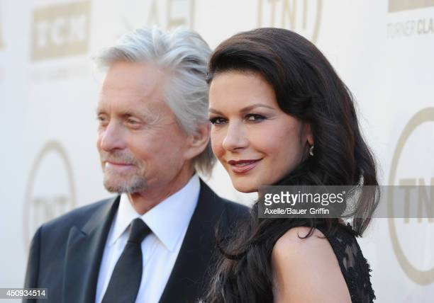 Actors Michael Douglas and Catherine ZetaJones arrive at the 2014 AFI Life Achievement Award Gala Tribute at Dolby Theatre on June 5 2014 in...