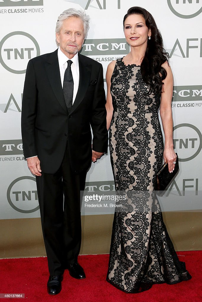 Actors Michael Douglas and Catherine Zeta-Jones attend the 2014 AFI Life Achievement Award: A Tribute to Jane Fonda at the Dolby Theatre on June 5, 2014 in Hollywood, California. Tribute show airing Saturday, June 14, 2014 at 9pm ET/PT on TNT.