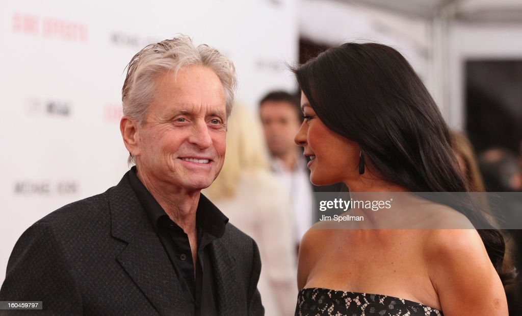 Actors <a gi-track='captionPersonalityLinkClicked' href=/galleries/search?phrase=Michael+Douglas&family=editorial&specificpeople=171111 ng-click='$event.stopPropagation()'>Michael Douglas</a> and Catherine Zeta-Jones attend the Open Road with the Cinema Society and Michael Kors Host the Premiere of 'Side Effects' at AMC Lincoln Square Theater on January 31, 2013 in New York City.