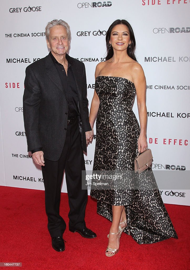 Actors <a gi-track='captionPersonalityLinkClicked' href=/galleries/search?phrase=Michael+Douglas&family=editorial&specificpeople=171111 ng-click='$event.stopPropagation()'>Michael Douglas</a> and Catherine Zeta-Jones attends the Open Road With The Cinema Society And Michael Kors Host The Premiere Of 'Side Effects' at AMC Lincoln Square Theater on January 31, 2013 in New York City.