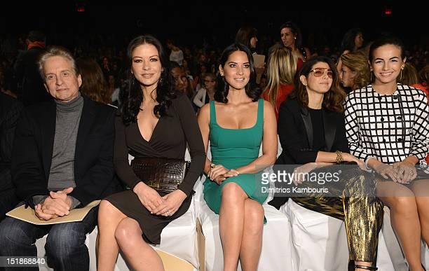 Actors Michael Douglas Catherine ZetaJones Olivia Munn Marisa Tomei and Camilla Belle attend the Michael Kors Spring 2013 fashion show during...