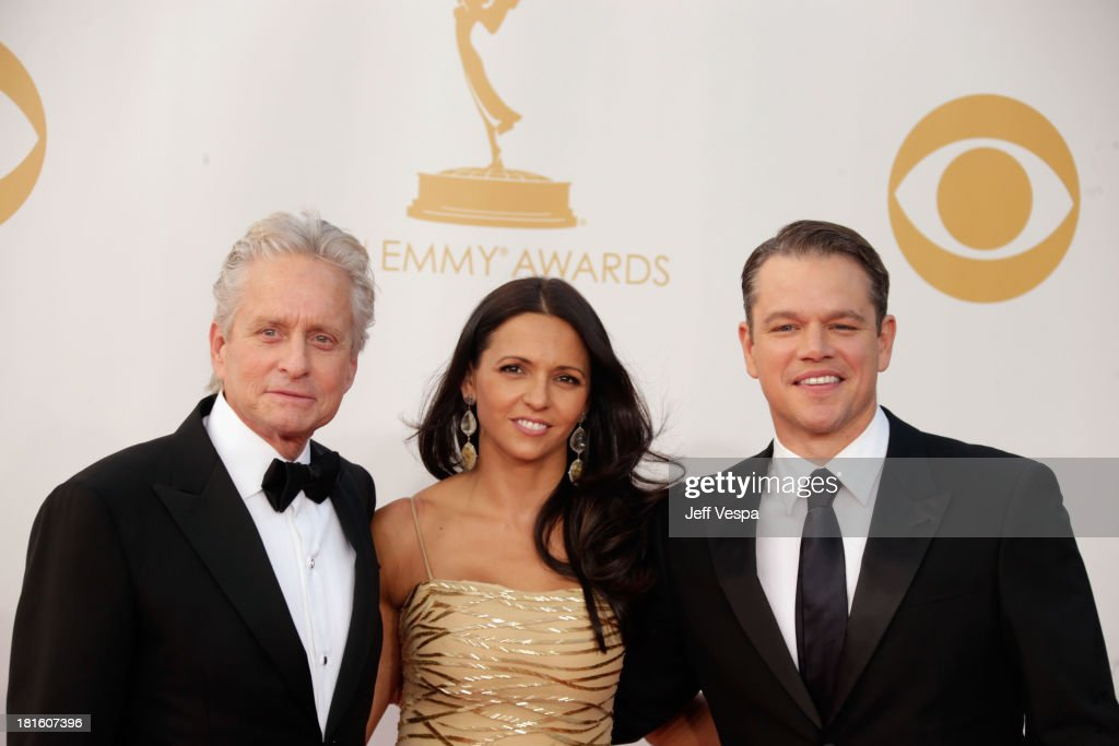 Actors Michael Douglas, Matt Damon (R) and Luciana Damon arrive at the 65th Annual Primetime Emmy Awards held at Nokia Theatre L.A. Live on September 22, 2013 in Los Angeles, California.