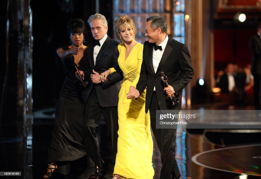 Actors <a gi-track='captionPersonalityLinkClicked' href=/galleries/search?phrase=Michael+Douglas&family=editorial&specificpeople=171111 ng-click='$event.stopPropagation()'>Michael Douglas</a>,<a gi-track='captionPersonalityLinkClicked' href=/galleries/search?phrase=Jane+Fonda&family=editorial&specificpeople=202174 ng-click='$event.stopPropagation()'>Jane Fonda</a>, and Director <a gi-track='captionPersonalityLinkClicked' href=/galleries/search?phrase=Ang+Lee&family=editorial&specificpeople=215104 ng-click='$event.stopPropagation()'>Ang Lee</a> accepts Academy Award for Best Director seen from backstage during the Oscars held at the Dolby Theatre on February 24, 2013 in Hollywood, California.