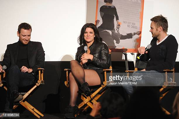 Actors Michael Fassbender and Gina Carano and moderator Joel McHale attend the AFI FEST 2011 Presented By Audi secret screening of 'Haywire' held at...