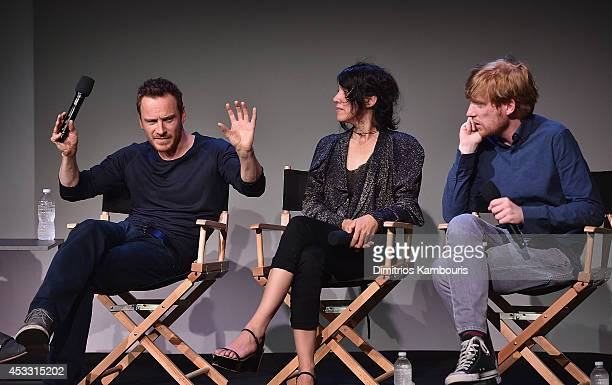 Actors Michael Fassbender Carla Azar and Domhnall Gleeson attend 'Meet The Actor' at Apple Store Soho on August 7 2014 in New York City