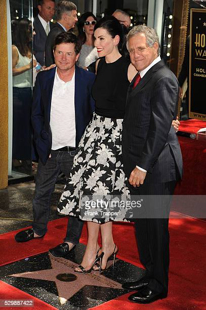 Actors Michael J Fox Juliana Margulies and Les Moonves pose at the ceremony that honored her with a Star on the Hollywood Walk of Fame