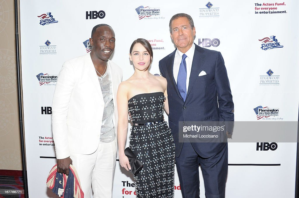 Actors Michael K. Williams and Emilia Clarke pose with HBO CEO Richard Plepler at the 2013 Actors Fund's Annual Gala honoring Robert De Niro at The New York Marriott Marquis on April 29, 2013 in New York City.