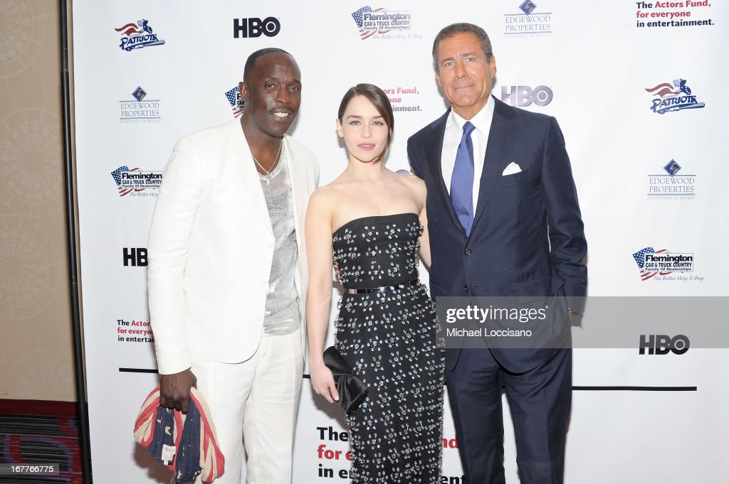 Actors <a gi-track='captionPersonalityLinkClicked' href=/galleries/search?phrase=Michael+K.+Williams&family=editorial&specificpeople=855658 ng-click='$event.stopPropagation()'>Michael K. Williams</a> and <a gi-track='captionPersonalityLinkClicked' href=/galleries/search?phrase=Emilia+Clarke&family=editorial&specificpeople=7426687 ng-click='$event.stopPropagation()'>Emilia Clarke</a> pose with HBO CEO <a gi-track='captionPersonalityLinkClicked' href=/galleries/search?phrase=Richard+Plepler&family=editorial&specificpeople=584118 ng-click='$event.stopPropagation()'>Richard Plepler</a> at the 2013 Actors Fund's Annual Gala honoring Robert De Niro at The New York Marriott Marquis on April 29, 2013 in New York City.