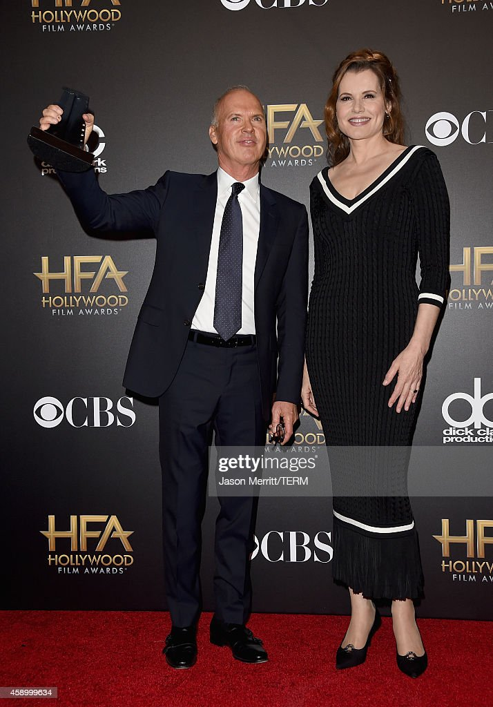 Actors Michael Keaton (L), winner of the Career Achievement award, and Geena Davis pose in the press room during the 18th Annual Hollywood Film Awards at The Palladium on November 14, 2014 in Hollywood, California.
