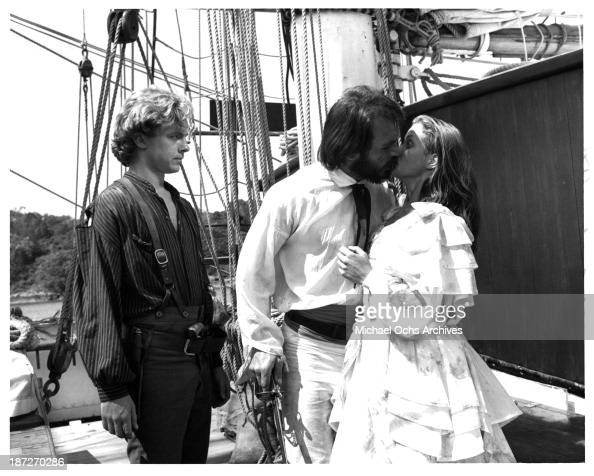 Actors Michael O'Keefe and Tommy Lee Jones with actress Jenny Seagrove on set of the Paramount Pictures movie 'Savage Islands' in 1983