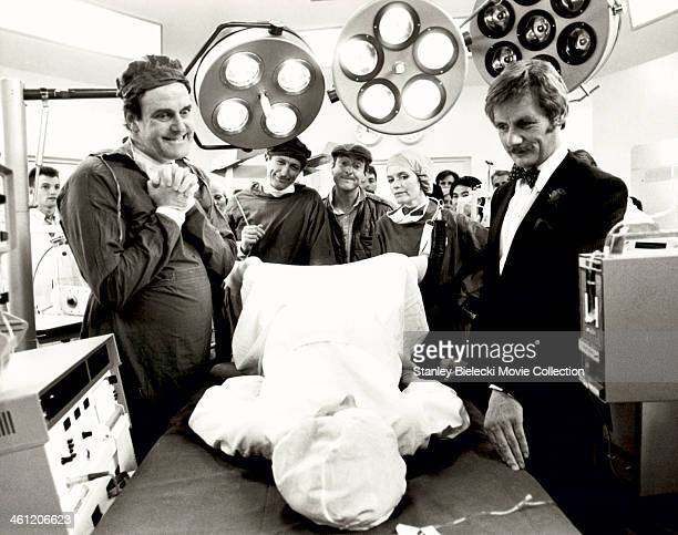 Actors Michael Palin John Cleese Graham Chapman and Eric Idle in a hospital scene from the film 'Monty Python's The Meaning of Life' 1983