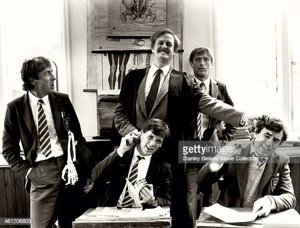 Actors Michael Palin John Cleese Graham Chapman Terry Jones and Eric Idle in a schoolroom scene from the film 'Monty Python's The Meaning of Life'...