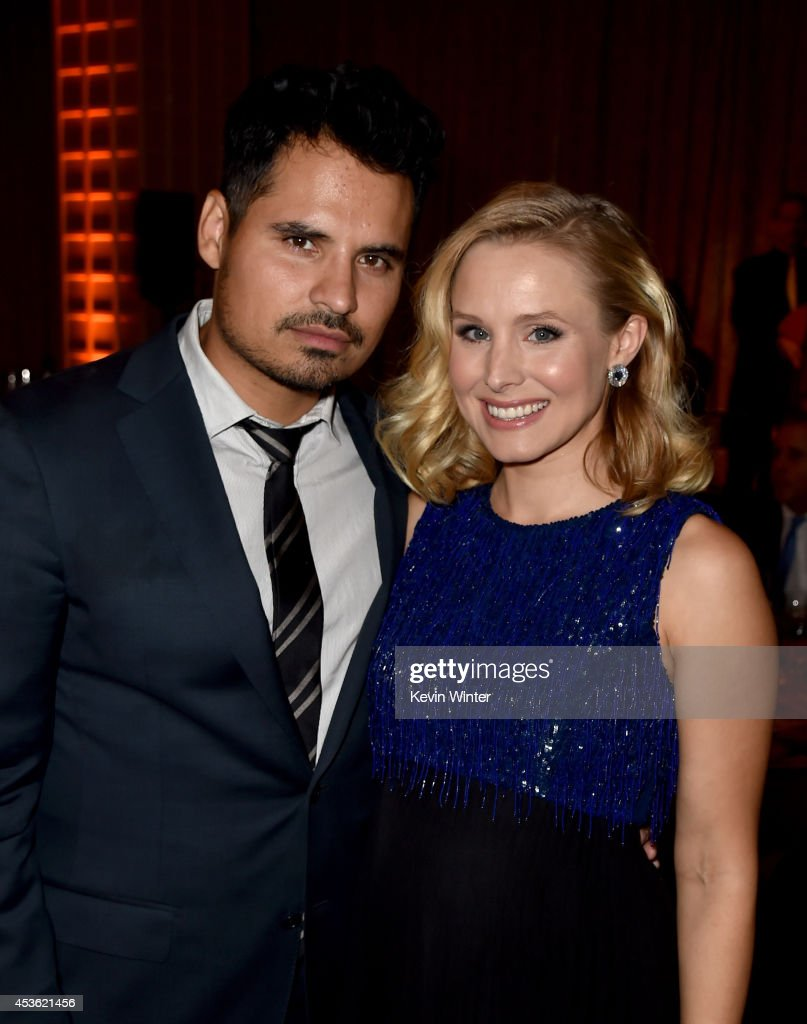 Actors Michael Pena and Kristen Bell attend the Hollywood Foreign Press Association's Grants Banquet at The Beverly Hilton Hotel on August 14 2014 in...