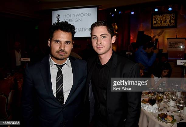 Actors Michael Pena and Logan Lerman attend the Hollywood Foreign Press Association's Grants Banquet at The Beverly Hilton Hotel on August 14 2014 in...