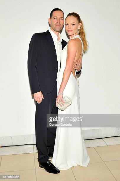 Actors Michael Polish and Kate Bosworth carrying Early Fall 2014 Mist Metal Intreccio Placcato Knot clutch attend the Hammer Museum's 12th annual...