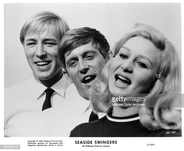 Actors Michael Sarne John Leyton and actress Grazina Frame on set of the Embassy Pictures movie 'Seaside Swingers' in 1965