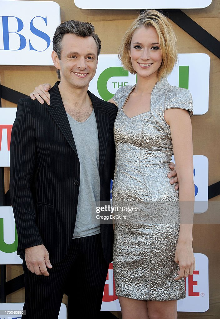Actors Michael Sheen and Caitlin FitzGerald arrive at the CBS/CW/Showtime Television Critic Association's summer press tour party at 9900 Wilshire Blvd on July 29, 2013 in Beverly Hills, California.