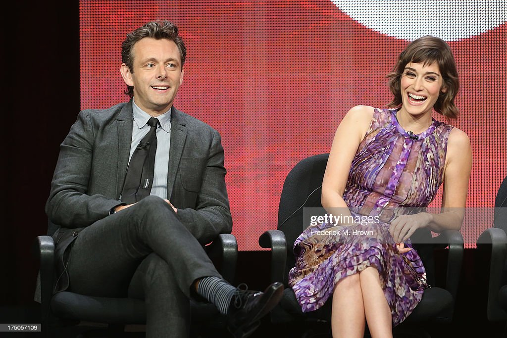 Actors <a gi-track='captionPersonalityLinkClicked' href=/galleries/search?phrase=Michael+Sheen&family=editorial&specificpeople=213120 ng-click='$event.stopPropagation()'>Michael Sheen</a> and <a gi-track='captionPersonalityLinkClicked' href=/galleries/search?phrase=Lizzy+Caplan&family=editorial&specificpeople=599560 ng-click='$event.stopPropagation()'>Lizzy Caplan</a> speak onstage during the 'Masters of Sex' panel discussion at the CBS, Showtime and The CW portion of the 2013 Summer Television Critics Association tour at the Beverly Hilton Hotel on July 30, 2013 in Beverly Hills, California.