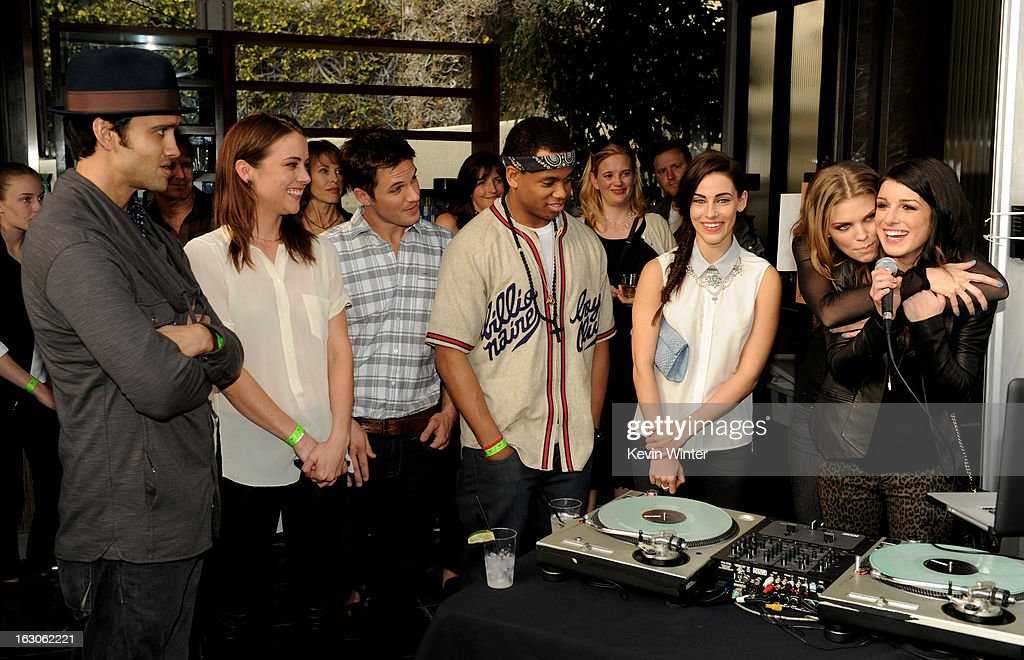 Actors Michael Steger, Jessica Stroup, Matt Lanter, Tristan Wilds, Jessica Lowndes, AnnaLynne McCord and Shenae Grimes pose at the CW Network's '90210' Season 5 Wrap Party on March 3, 2013 in Los Angeles, California.