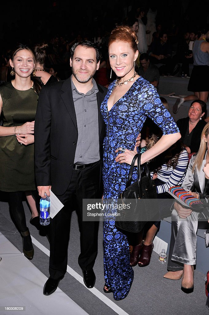 Actors Michael Stuhlbarg (L) and Christiane Seidel attend the Nanette Lepore fashion show during Mercedes-Benz Fashion Week Spring 2014 at The Stage at Lincoln Center on September 11, 2013 in New York City.
