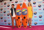 Actors Michael Trevino and Candice Accola winners of Choice Fantasy/SciFi Show award pose in the press room during the 2012 Teen Choice Awards at...