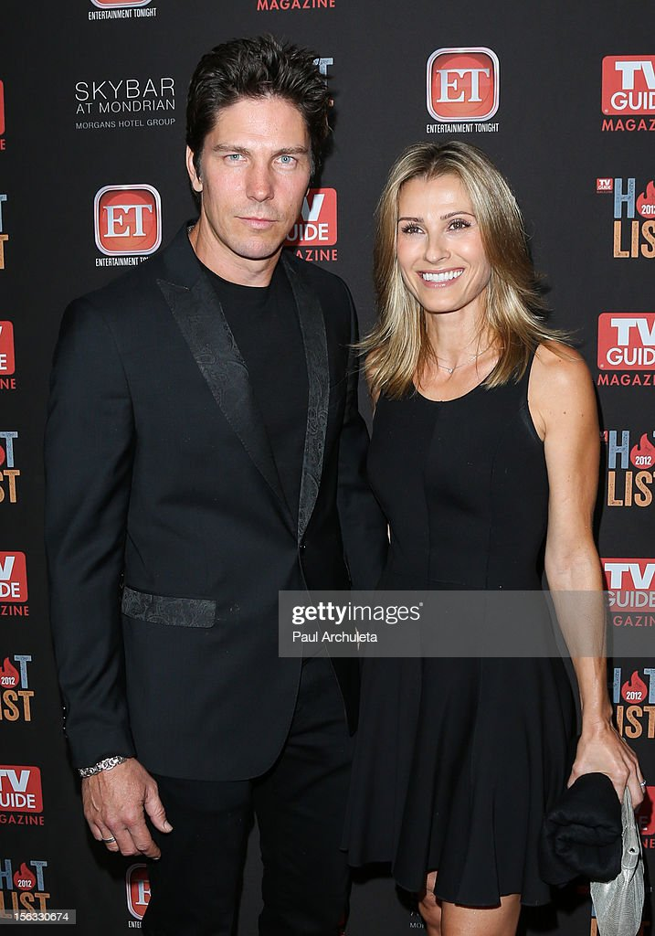 Actors Michael Trucco (L) and Sandra Hess attend the TV Guide Magazine Hot List Party at SkyBar at the Mondrian Los Angeles on November 12, 2012 in West Hollywood, California.