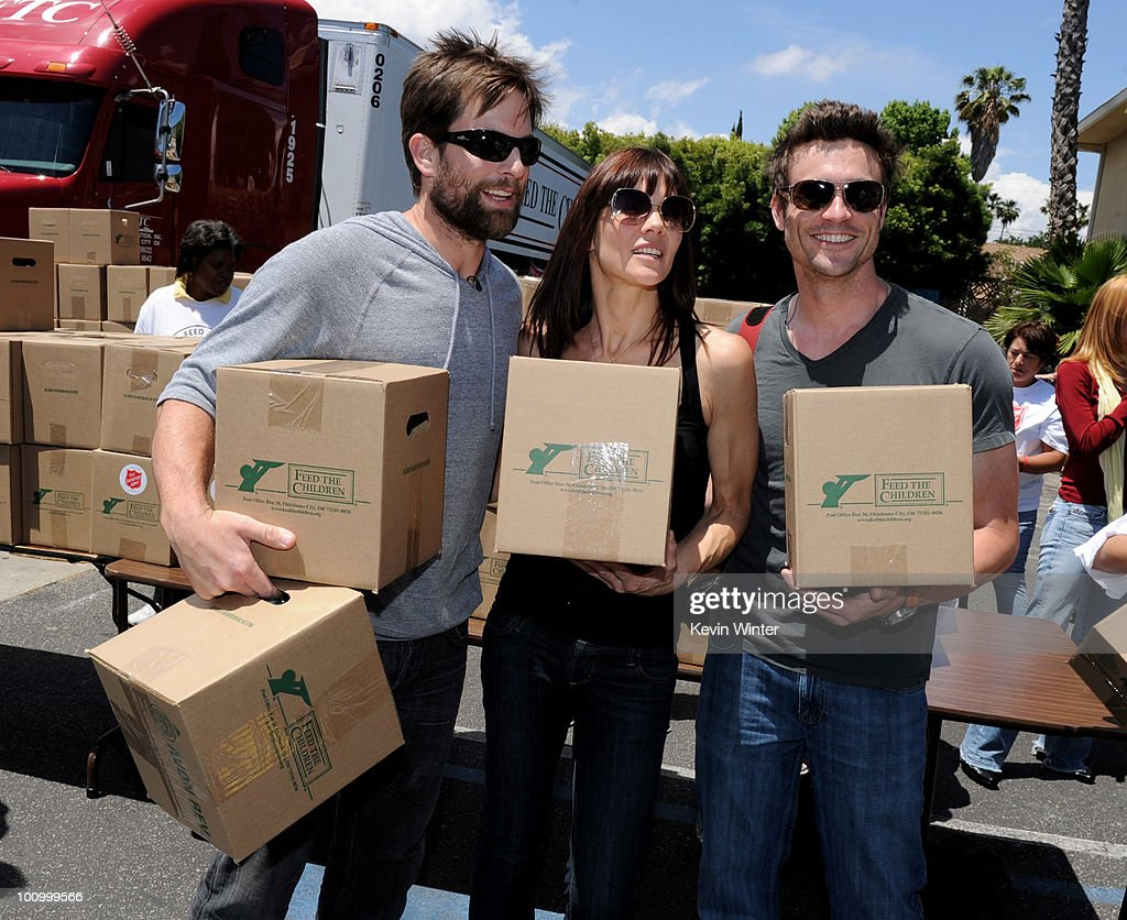 Actors Micheal Muhney, Stacy Haiduk and Daniel Goddard help distribute food at the 37th Annual Daytime Emmy Awards' 'Daytime Gives Back' at the Salvation Army on May, 26, 2010 in Van Nuys, California.