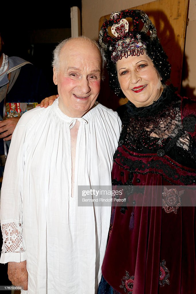 Actors Michel Bouquet (L) and his wife Juliette Carre after 'Le Roi se meurt' on the last day of the 29th Ramatuelle Festival on August 11, 2013 in Ramatuelle, France.