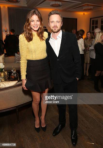 Actors Michelle Monaghan and Aaron Paul attend the Hulu Holiday Party at Spago on November 24 2015 in Beverly Hills California