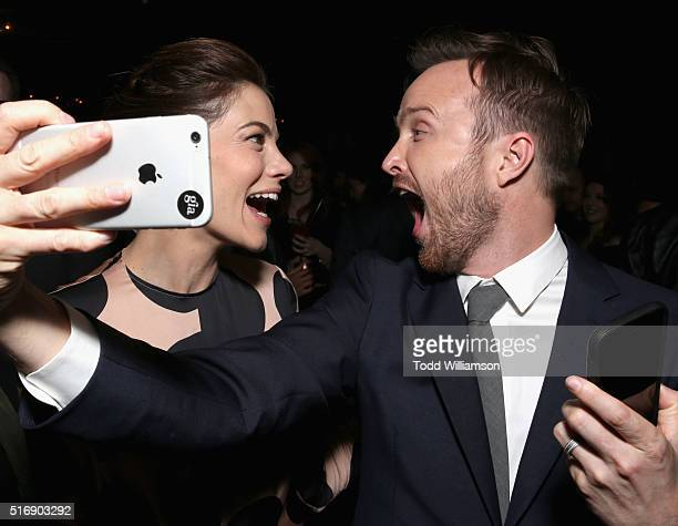 Actors Michelle Monaghan and Aaron Paul take a selfie at The Path Premiere Party at ArcLight Hollywood on March 21 2016 in Hollywood California