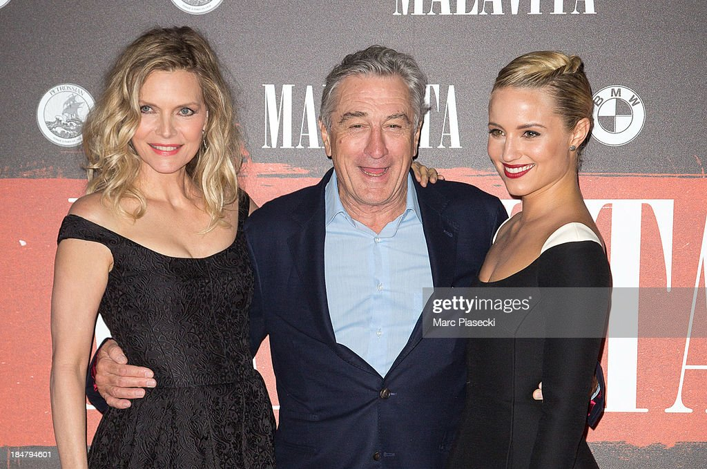 Actors <a gi-track='captionPersonalityLinkClicked' href=/galleries/search?phrase=Michelle+Pfeiffer&family=editorial&specificpeople=212951 ng-click='$event.stopPropagation()'>Michelle Pfeiffer</a>, Robert de Niro and <a gi-track='captionPersonalityLinkClicked' href=/galleries/search?phrase=Dianna+Agron&family=editorial&specificpeople=4439685 ng-click='$event.stopPropagation()'>Dianna Agron</a> attend the 'Malavita' premiere on October 16, 2013 in Roissy-en-France, France.