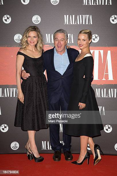 Actors Michelle Pfeiffer Robert de Niro and Dianna Agron attend the 'Malavita' premiere on October 16 2013 in RoissyenFrance France