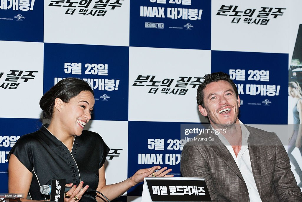 Actors <a gi-track='captionPersonalityLinkClicked' href=/galleries/search?phrase=Michelle+Rodriguez&family=editorial&specificpeople=206182 ng-click='$event.stopPropagation()'>Michelle Rodriguez</a> and Luke Evans attend the 'Fast & Furious 6' press conference on May 13, 2013 in Seoul, South Korea.