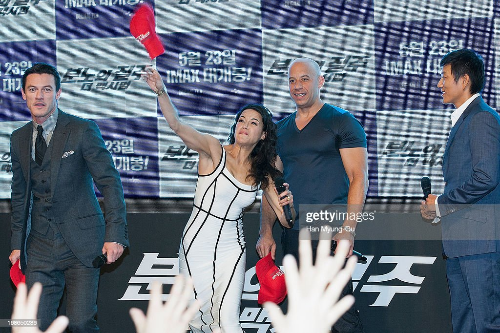 Actors Michelle Rodriguez and Vin Diesel throwing the hat to their fans the 'Fast & Furious 6' South Korea Premiere on May 13, 2013 in Seoul, South Korea. Michelle Rodriguez and Vin Diesel are visiting South Korea to promote their recent film 'Fast & Furious 6' which will be released in South Korea on May 23.