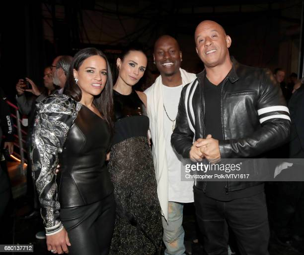 Actors Michelle Rodriguez Jordana Brewster Tyrese Gibson and Vin Diesel attend the 2017 MTV Movie And TV Awards at The Shrine Auditorium on May 7...