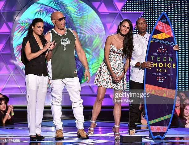 Actors Michelle Rodriguez Vin Diesel Jordana Brewster and Ludacris accept the Choice Movie Action Award for Furious 7 onstage during the Teen Choice...